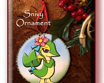 Pokemon 'SNIVY' Wood Decoupage Ornament, 3 inch disc with wood burned edges.