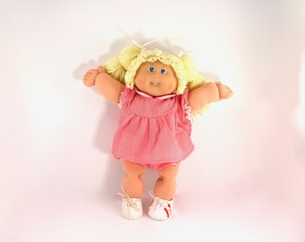 1985 vintage Cabbage Patch Kid - blonde girl with pigtails, blue eyes, yellow hair, tooth, dress, dimple, 80s, 1980s toys, dolls