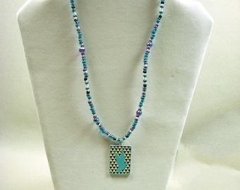 Teal and purple necklace w/ bird pendant