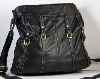 Upcycled leather handbag from repurposed leather jacket having adjustable cross-body strap