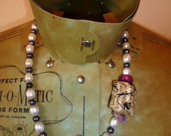 Freshwater pearl necklace with offset statement detail