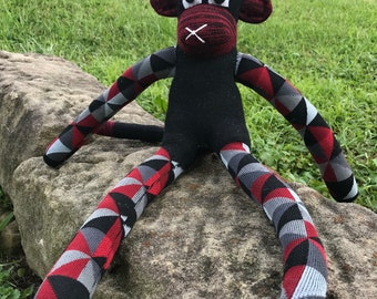 Black and Maroon Sock Monkey with a Geometric Pattern