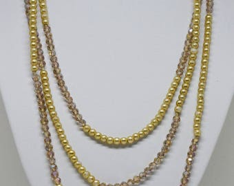 Charming gold tone sparkling necklace