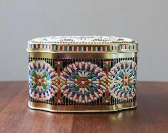 Vintage floral caramel tin.