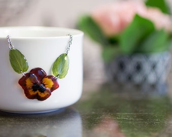 Pansy with leaves dark red flower necklace. Comes in a gift box.