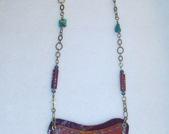 Fabulous leather bib necklace with authentic turquoise pendant.