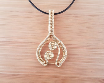 Gold wire wrapped spiral shaped pendant necklace