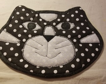 Cat potholder black spots
