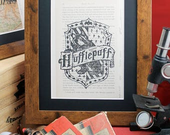 Hufflepuff linocut on upcycled Harry Potter book. Limited edition Order of the Phoenix lino print inc.  Gryffindor, Ravenclaw & Slytherin