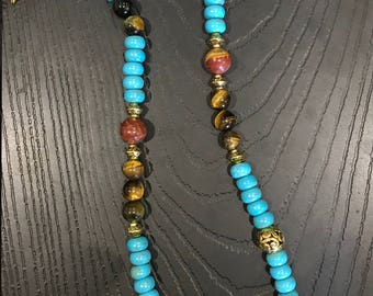 Turquoise and tigers eye with gold spacer beads and toggle clasp.