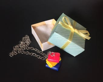 Polymer clay stack of books necklace charm in a gift box