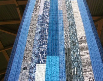 "BLUE BRUSHSTROKE Handmade quilted table runner 14"" x 58"" Modern improv strip layout. Solids & prints in shades of blue, gray + black, white"