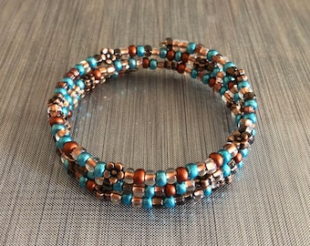 Blue copper flower bead memory wire bracelet