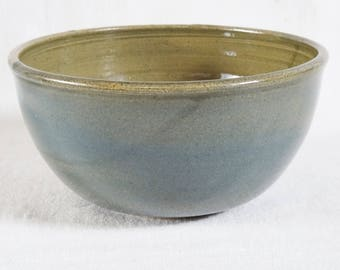 Breakfast bowl. Handmade, thrown, and turned stoneware bowl. Blue decorating slip with transparent green glaze.
