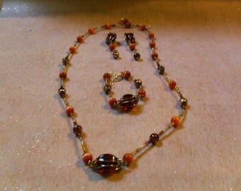 set (necklace, bracelet, earrings) this stylish, original (Brown)