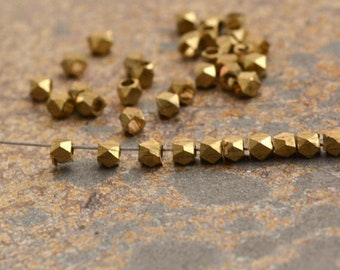2mm square bevelled brass spacer bead.