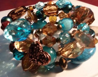 This is a gorgeous bracelet  in blue and browns.  It would is a very thoughtful gift anyone would be  excited to wear.