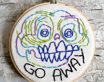 "blue & green GO AWAY skull - 4"" hand embroidered wall hanging"