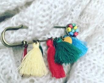 Multicolored hand brooch