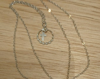 Delicate sterling silver cross pendant and chain