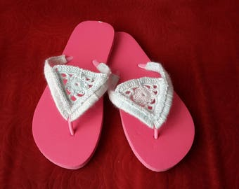 Flip-flops with crocheted decoration