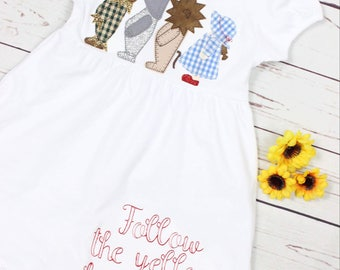 Follow the yellow brick road, lion, scarecrow, tin man, dorthy, red glitter shoes, applique, yellow brick road, ruffle dress, toddler dress