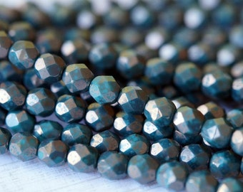 6mm Persian Turquoise with Bronze Picasso Finish Round Faceted Beads