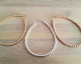 Set of Three - 4mm 14kt Gold Filled, Sterling Silver, 14kt Rose Gold beaded bracelets.