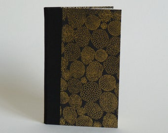 Phone book address book, 80 pages. Japanese paper, flowers, gold on black background.