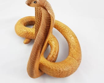 Cobra carved by hand