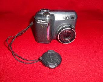 One (1), Vintage Nikon, Cool Pix 855, Digital Camera.