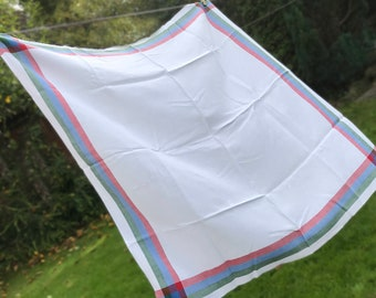 White with red blue and green border. 32 inches square. Tearoom tablecloth. Picnic cloth.