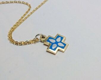 Golden cross with jewelry enamel