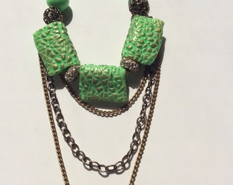 Bib necklace. Lime green, textured crackle pattern, polymer clay necklace. Inca gold patina. Sparkly rhinestone  beads.