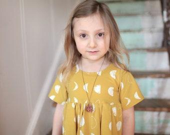 Bohemian Babies mustard moon phase dress//Short sleeve knit dress//Girl's dress//Twirl dress//Yellow dress//Sizes 2T to 12//Made to order