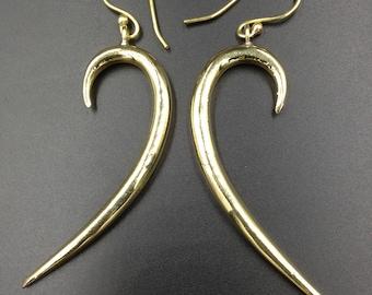 Long comma brass earrings.