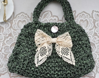 Elegant coquette bag, in green black shades, with a lace ribbon