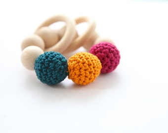 Teething toy with crochet dark berry, orange, petrol green wooden beads and 2 wooden rings. Wooden rattle. Gift for baby and mom.