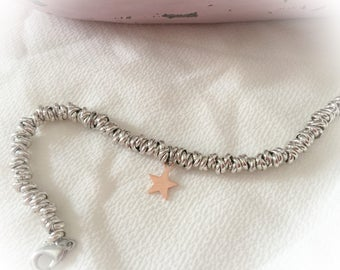 Bracelet with knots in pink aluminum and star pendant