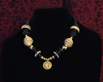 Coconut wood necklace with Pisces pendant