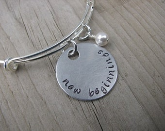 """New Beginnings Inspiration Bracelet- Hand-Stamped """"new beginnings""""  Bracelet with an accent bead in your choice of colors"""