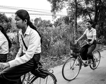 Students riding bicycles in Siem Reap, Cambodia