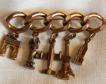 Vintage Charm Pin or Brooch -- Paris and New York