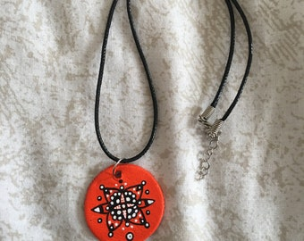 Orange patterned circle necklace