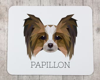 A computer mouse pad with a Papillon dog. A new collection with the geometric dog