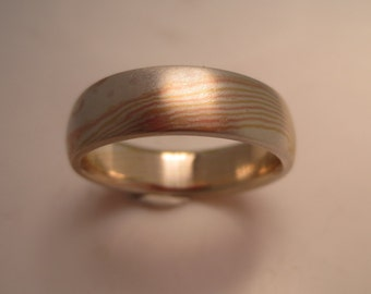 18K Royal  Yellow Gold, 14K Rose Gold and Sterling Silver Unique Beautiful tricolor mixed metal. Custom cool wave pattern Mokume Gane