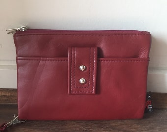 Beautiful soft luxurious leather wallet and quality purse. Wristlet and two generous pockets on either side. Room for cards and coins.