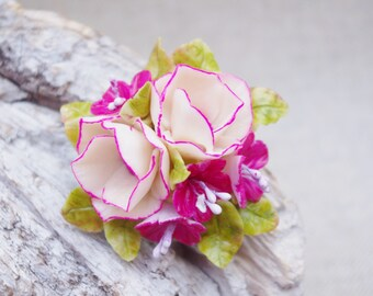 Floral brooch is molded of cold porcelain