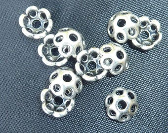 10 9mm decorated silver metal caps