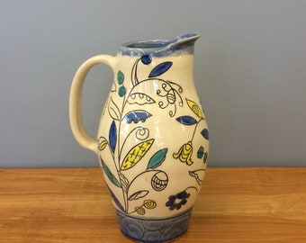 Handmade Pitcher with Leaf Deco. Glazed in Clear and Blue. MA124